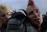 Кадр с фильма Безумный Макс 0: Воин дороги торрент 08789 план 0