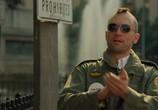 Кадр изо фильма Таксист торрент 068811 люди 0
