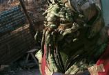 Кадр с фильма Район №9 торрент 01771 сцена 0
