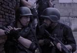 Кадр с фильма Рейд торрент 001066 работник 0