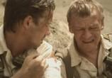 Сцена из фильма Охотники за караванами (2010) Охотник за караванами сцена 1