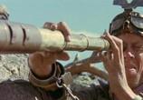 Кадр с фильма Безумный Макс 0: Воин дороги торрент 08789 люди 0